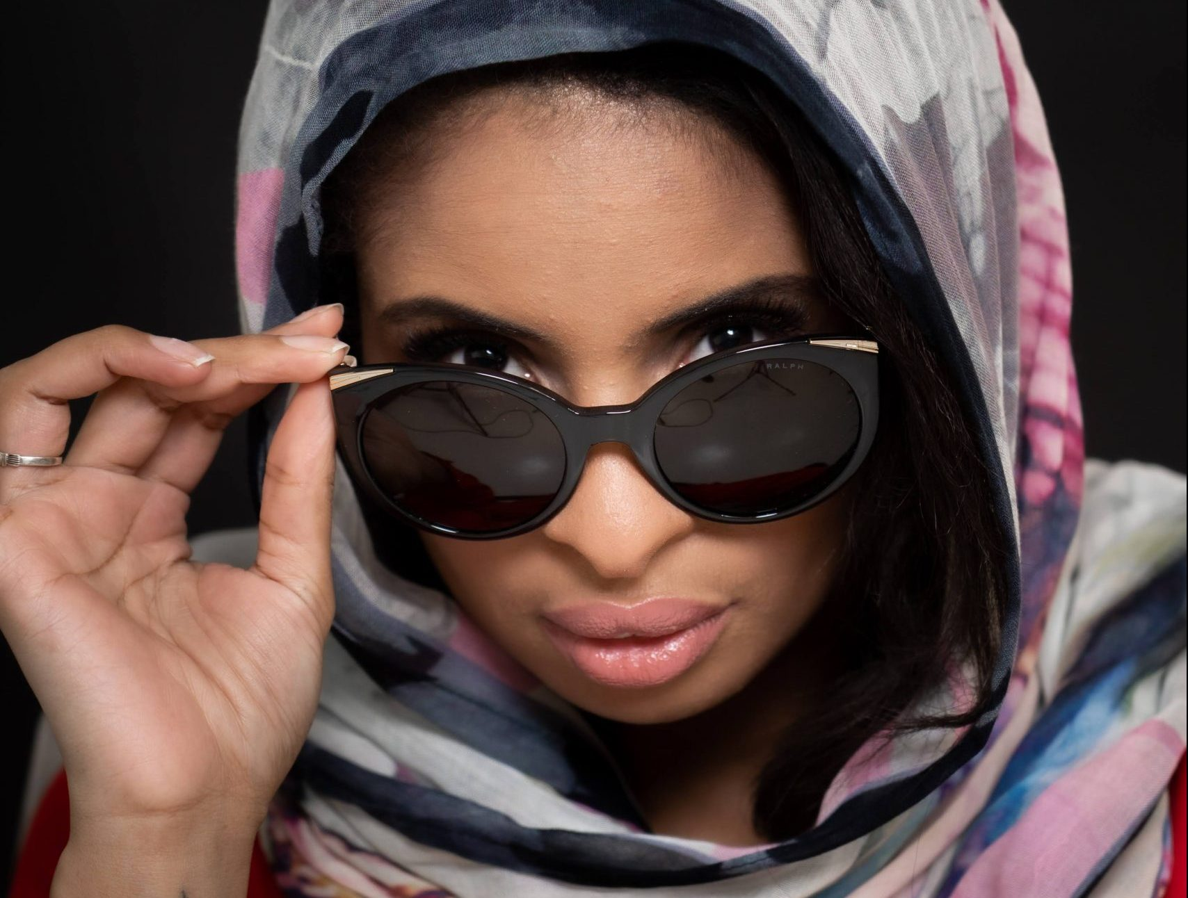 Model wearing tinted Vogue Optical sugnlasses